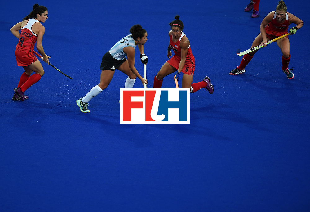 Argentina's Rocio Sanchez (C) tries to get past the USA's Melissa Gonzalez and other defenders during the women's field hockey Argentina vs USA match of the Rio 2016 Olympics Games at the Olympic Hockey Centre in Rio de Janeiro on August, 6 2016. / AFP / MANAN VATSYAYANA        (Photo credit should read MANAN VATSYAYANA/AFP/Getty Images)