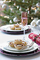 Mince pies on plate on dining table