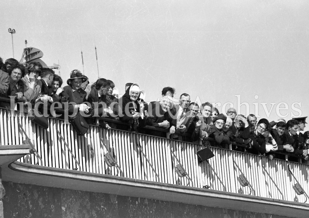 Jacqueline Kennedy's visit to Ireland, June 1967.<br /> (Jacqueline &quot;Jackie&quot; Lee Bouvier Kennedy Onassis)<br /> At Shannon Airport.<br /> Crowds of people spectate from a balcony.<br /> (Part of the Independent Ireland Newspapers/NLI Collection)