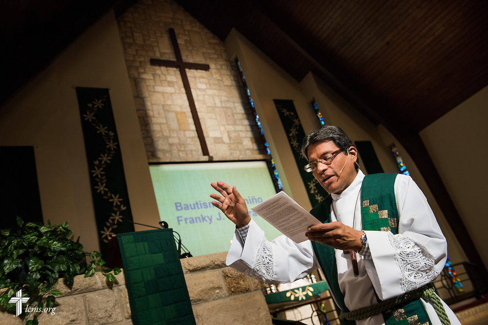 The Rev. Adolfo Borges, associate pastor at Prince of Peace Lutheran Church in Orlando, Fla., prepares to baptize Franky Pastrana during worship at the church on Sunday, Sept. 13, 2015. LCMS Communications/Erik M. Lunsford