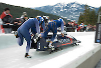 The British team of Lee johnston, Karl Johnston, Allyn Condon and Dan Money compete in the Mens' four-person bobsleigh World Cup competition held at the Whistler Sliding Centre on Feb 7, 2009