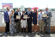 Jennifer Judkins, third right, and Juan-Carlos Capelli, center right, both of Longines, award representatives from Amerman Racing Stables, left, jockey Javier Castellano, center, and trainer Brian Lynch, right, with their Longines timepieces after Coffee Clique wins the Churchill Distaff Turf Mile presented by Longines, Saturday, May 3, 2014, in Louisville, Ky.  Longines, the Swiss watchmaker known for its famous timepieces, is the Official Watch and Timekeeper of the 140th annual Kentucky Derby. (Photo by Diane Bondareff/Invision for Longines/AP Images)