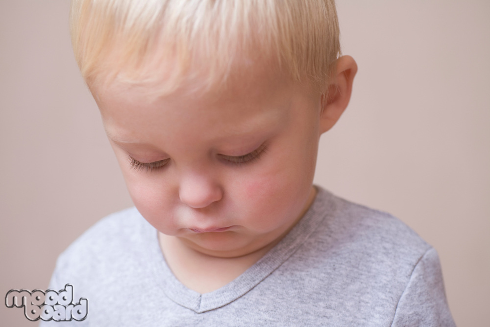 Blonde toddler looking unhappy
