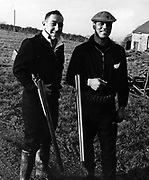 Kevin Briscoe and Waka Nathan game-shooting in Wales, 1963.<br /> Photosport