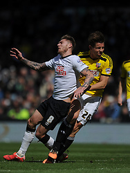 Brentford Jason Tarkowski Clashes with Derby Jeff Hendrick, Derby County v Brentford, Sy Bet Championship, IPro Stadium, Saturday 11th April 2015. Score 1-1,  (Bent 92) (Pritchard 28)<br /> Att 30,050