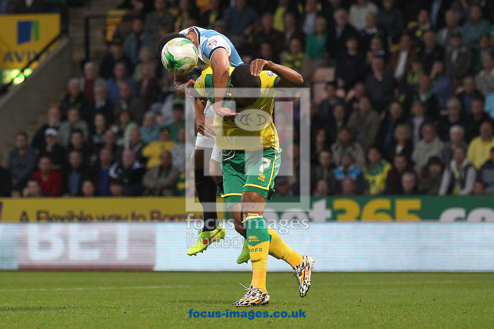 Jason Lowe of Blackburn Rovers and Lewis Grabban of Norwich in action during the Sky Bet Championship match at Carrow Road, Norwich<br /> Picture by Paul Chesterton/Focus Images Ltd +44 7904 640267<br /> 19/08/2014