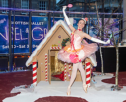 Scottish Ballet dancer Grace Paulley joins local children in front of a festive gingerbread house ahead of the opening night of Hansel and Gretel.