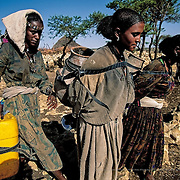 Sindu Kasi (in the middle) is 16 years old and lives in the small village of Tata. She goes out looking for water twice every day, in the early morning and at noon and spends more than six hours total travelling back and forth for water. She had to stop going to school because she didn't have enough time. She would have liked to have been a doctor. Samre, Ethiopia.