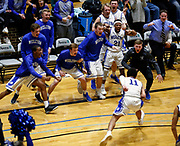 The bench reacts to a basket and the foul called on Dakota Wesleyan's Tyson Smiley (11) during a Great Plains Athletic Conference game against Northwestern on Wednesday night at the Corn Palace. (Matt Gade / Republic)