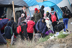 October 24, 2016 - Calais, Calais, France - Calais , France . People queue to leave the Jungle migrant camp in Calais , Northern France , on the day of a planned eviction and start of the destruction of the camp  (Credit Image: © Joel Goodman/London News Pictures via ZUMA Wire)