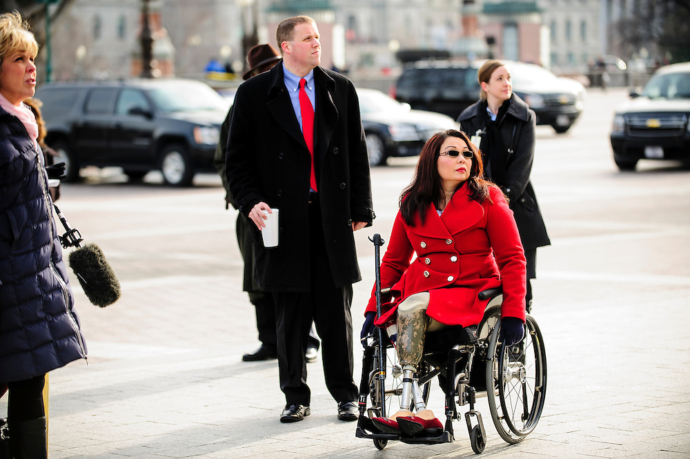 Rep. elect Tammy Duckworth (D-IL) arrives at the Senate steps to welcome Senator Mark Kirk (R-IL) as he makes his return to Congress at the U.S. Capitol in Washington, District of Columbia, U.S., on Thursday, Jan. 3, 2013. Kirk, 53, climbed the steps at 10:30 a.m. accompanied by Vice President Joe Biden and Senator Dick Durbin (D-IL). The 133th Congress begins Thursday with the swearing in of newly elected Members of Congress and the election of the Speaker of the House of Representatives. Photographer: Pete Marovich/Bloomberg