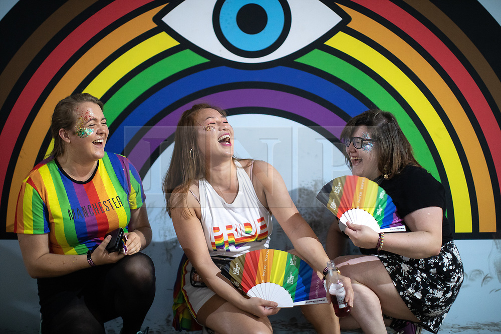 © Licensed to London News Pictures . 25/08/2019. Manchester, UK. ABIGAIL (25) , WENDY (26) and PHILIPPA (27) , from London . Fans of Ariana Grande and other musical acts gather at Mayfield Depot ahead of performances this evening . Manchester's annual Gay Pride festival , which is the largest of its type in Europe , celebrates LGBTQ+ life . Photo credit: Joel Goodman/LNP