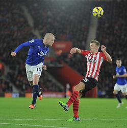 Everton's Steven Naismith heads the ball over Southampton's James Ward-Prowse - Photo mandatory by-line: Alex James/JMP - Mobile: 07966 386802 - 20/12/2014 - SPORT - Football - Southampton  - St Mary's Stadium - Southampton  v Everton - Football