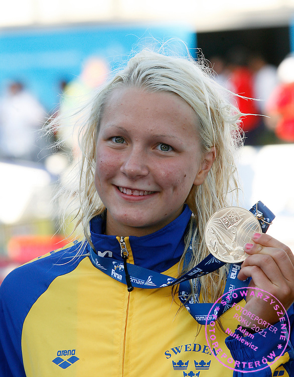 ROME 27/07/2009.13th Fina World Championships.Sweden's Sarah Sjostrom shows the gold medal of the Women's 100M Butterfly, at the FINA Swimming World Championships in Rome.photo: Piotr Hawalej / WROFOTO