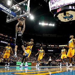 January 22, 2011; New Orleans, LA, USA; San Antonio Spurs forward Tiago Splitter (22) dunks over New Orleans Hornets center Emeka Okafor (50) during the second half at the New Orleans Arena. The Hornets defeated the Spurs 96-72.  Mandatory Credit: Derick E. Hingle