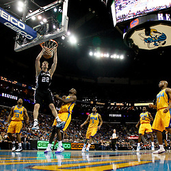 January 22, 2011; New Orleans, LA, USA; San Antonio Spurs forward Tiago Splitter (22) dunks over New Orleans Hornets center Emeka Okafor (50) during the second half at the New Orleans Arena. The Hornets defeated the Spurs 96-72.  Mandatory Credit: Derick E. Hingle