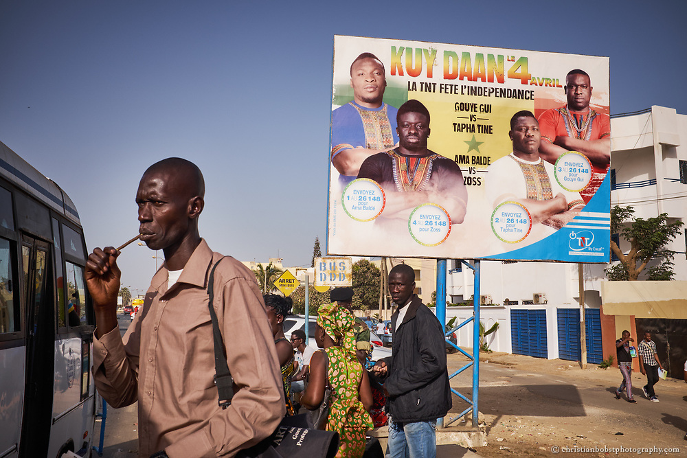 April 2, 2015. A poster on a Bus station in Dakar advertises a bit fight that takes place on April 4, 2015, the Senegalese independence day. Independence day is always celebrated with some major fights at the stadiums of Dakar.