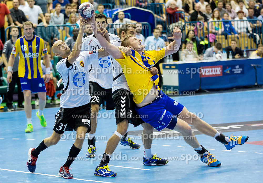 Timur Dibirov of Vardar vs Blaz Blagotinsek of Celje PL during handball match between RK Celje Pivovarna Lasko and HC Vardar Skopje (MKD) in 1st Round of Group C of EHF Champions League 2014/15, on September 27, 2014 in Arena Zlatorog, Celje, Slovenia. Photo by Vid Ponikvar / Sportida.com