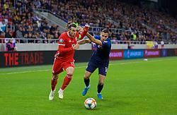 TRNAVA, SLOVAKIA - Thursday, October 10, 2019: Wales' captain Gareth Bale (L) and Slovakia's Dávid Hancko during the UEFA Euro 2020 Qualifying Group E match between Slovakia and Wales at the Štadión Antona Malatinského. (Pic by David Rawcliffe/Propaganda)