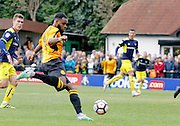 Merstham Defender Marc-Anthony Okoye has a shot on goal during the FA Cup match between Merstham and Oxford United at Moatside, Merstham, United Kingdom on 5 November 2016. Photo by Andy Walter.