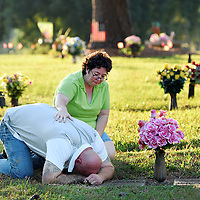 Barbara Iverson comforts her cousin Johnny Small as he visits the gravesites of his grandparents at Oleander Memorial Gardens after his ankle monitor was removed in Wilmington, N.C., Thursday September 8, 2016. Small was required to wear the ankle monitor as part of his release from prison last month after a judge vacated his sentence. New Hanover County District Attorney Ben David announced that his office would not be filing new charges against him. Mike Spencer/StarNews