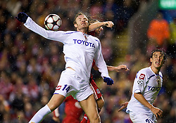 LIVERPOOL, ENGLAND - Wednesday, December 9, 2009: Liverpool's Andrea Dossena and AFC Fiorentina's Cesare Natali during the UEFA Champions League Group E match at Anfield. (Photo by David Rawcliffe/Propaganda)