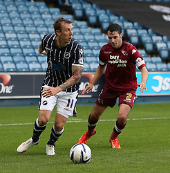 Millwall's Martyn Woolford takes the ball away from Derby County's Adam Smith  - Photo mandatory by-line: Robin White/JMP - Tel: Mobile: 07966 386802 14/09/2013 - SPORT - FOOTBALL -  The Den - London - Millwall V Derby County - Sky Bet League Championship