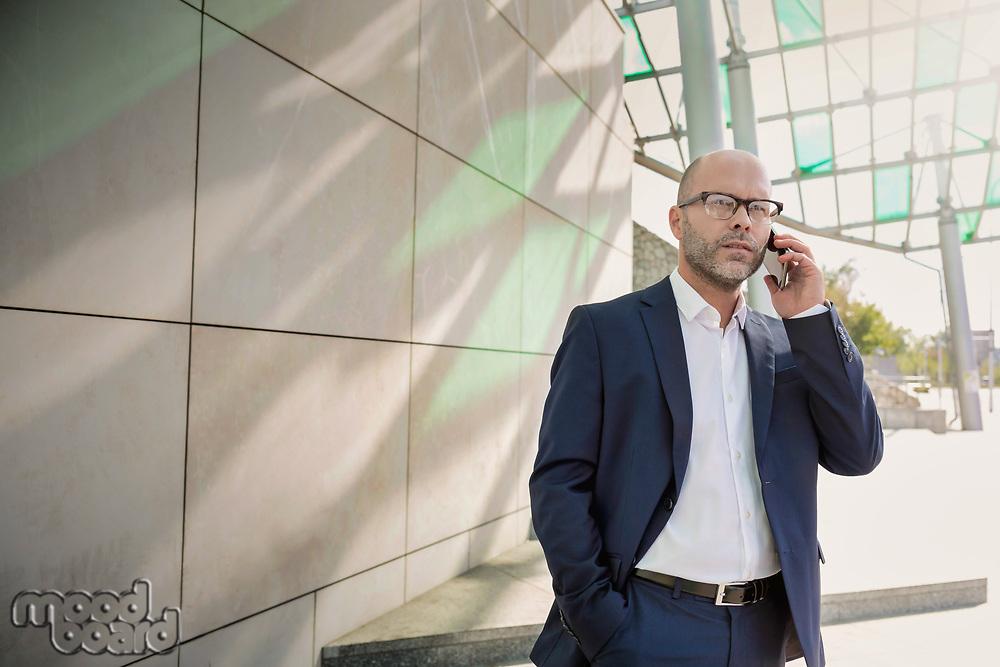 Portrait of businessman talking on smartphone