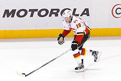 Jan 17, 2012; San Jose, CA, USA; Calgary Flames center Blair Jones (19) skates with the puck against the San Jose Sharks during the third period at HP Pavilion. San Jose defeated Calgary 2-1 in shootouts. Mandatory Credit: Jason O. Watson-US PRESSWIRE