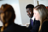 Graduate students talk in the board room at the college of management. Photo by Marc Hall