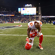Kansas City Chiefs wide receiver Jason Avant (81) knelt near midfield as the last Chiefs player off the field following the 27-20 loss to the New England Patriots in Saturday's AFC Divisional Playoff football game on January 16, 2016 at Gillette Stadium in Foxbourough, MA.