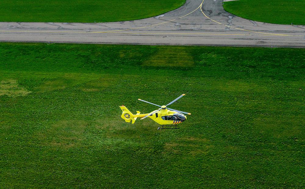 Nederland, Flevoland, Lelystad , 23-10-2013;  traumahelikopter (Lifeliner) met callsign PH-ULP van het Mobiel Medisch Team (MMT, traumateam) verlaat Vliegveld Lelystad<br /> Ambulance helicopter (lifeliner) with callsign PH-ULP of the Mobile Medical Team (MMT, trauma team) leaves Lelystad Airport.<br /> luchtfoto (toeslag op standaard tarieven);<br /> aerial photo (additional fee required);<br /> copyright foto/photo Siebe Swart.