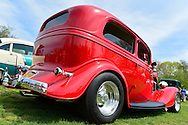 This red 1934 Ford 2-door sedan is at the Antique Auto Show, where New York Antique Auto Club members exhibited their cars on the farmhouse grounds of Queens County Farm Museum. Its owner, Dennis Kusold of Franklin Square, explained it has its original steel body and frame.