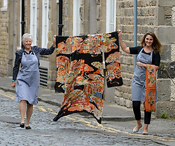 Pictured: Pictured: Bonham's Laura MacGregor and Charlotte Canby with a 19th century furisode komono and matching obi (belt) before the sale. It is expected to fetch £500 - £700 GBP.<br /> <br /> Rare Asian art was on show for a photocall before it goes up for sale at Bonham's in Edinburgh.<br /> <br /> © Dave Johnston / EEm