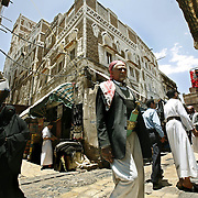 Yemenis walk through the market in the central souq of Old San'aa. UNESCO, the United Nations cultural organization, declared San'a a world heritage site in 1988. San'a was a trade capital as early as the 1st century B.C. With merchants crowded  inside the mud walls of the city, the San'anis built upwards -- as high as nine stories, an impressive feat given the technology of the time. San'aa's homes rest on lower stories built of stone; some date to the 9th or 10th centuries. Over generations, families added floors in brick, making each new floor slightly smaller than the previous one for stability.