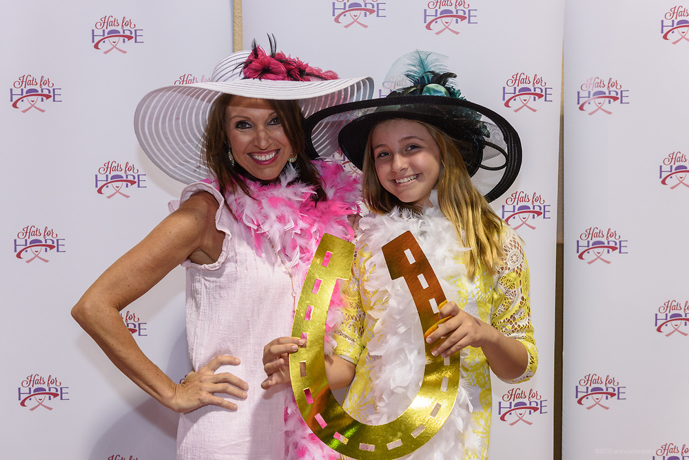 The 2017 Hats for Hope, a cocktail evening benefitting Kosair Charities that features a silent auction of new, designer and gently used Derby hats, tantalizing gift baskets and other donated services and merchandise Thursday April 20, 2017 in the Louisville Triple Crown Conference Center at 1776 Plantside Drive in Louisville, Ky. (Photo by Brian Bohannon)