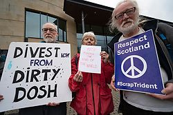 Edinburgh, Scotland, UK. 25 April, 2019. Protesters from Friends of the Earth and anti nuclear weapons group  Don't Bank on the Bomb stage protest outside RBS Conference Centre during the annual Shareholders Meeting
