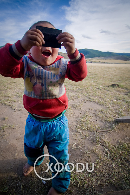 Young Mongolian boy playing (, Mongolia - Sep. 2008) (Image ID: 080909-1744591a)