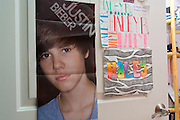 A Justin Bieber poster hangs on Haley Bergs door in Celina, Texas on January 23, 2014. Berg, a freshman at Celina High School, began receiving attention from top collegiate soccer programs when she was 13 and has already committed to the University of Texas. (Cooper Neill / for The New York Times)