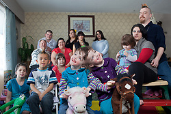 Portrait of four-year-old craniopagus twins Tatiana and Krista Hogan with their family in Vernon, British Columbia, Canada, Feb. 27, 2011. The twins were born on Oct. 25, 2006 to parents Felicia and Brendan Hogan, far right, and live in one house with their extended family. Neurologists say the twins are the only such set  that have a common neurological connection.