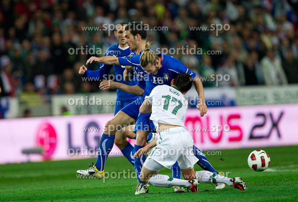 Federico Balzaretti of Italy vs Andraz Kirm of Slovenia during EURO 2012 Quaifications game between National teams of Slovenia and Italy, on March 25, 2011, SRC Stozice, Ljubljana, Slovenia. Italy defeated Slovenia 1-0.  (Photo by Vid Ponikvar / Sportida)