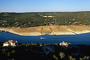 Boat launch troughs cut through the bank of the Colorado River near Lake Travis, one of six dams run by the LCRA (Lower Colorado River Authority). With drought and increased water use by industry, agriculture, recreation, and the environment, the reservoirs are running low.