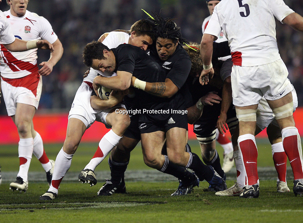 Leon MacDonald with help from Ma'a Nonu. Iveco test match series, All Blacks beat England 44-12, 2nd Test, AMI Stadium, Christchurch, Saturday 14 June 2008. Photo: Marc Weakley/PHOTOSPORT