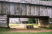 drive-through barn; Cable Mill complex; historic farm; hazy background; Great Smoky Mountains National Park; Cades Cove; TN; Tennessee; summer