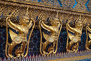 Garuda figures on the ubusot, the main building of Temple of the Emerald Buddha at The Grand Palace in Bangkok, Thailand.