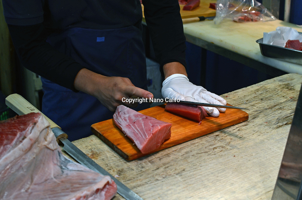 Specialist cutting tuna at Tsukiji Outer Market, known as the Jogai Shijo, Tokyo