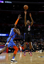 March 8, 2019 - Los Angeles, California, U.S - Los Angeles Clippers' Lou Williams (23) shoots over Oklahoma City Thunder's Jerami Grant (9) during an NBA basketball game between Los Angeles Clippers and Oklahoma City Thunder Friday, March 8, 2019, in Los Angeles. (Credit Image: © Ringo Chiu/ZUMA Wire)