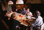 The owners of the winery Granja Nuestra Senora de Remelluri, S.A. at home, having supper in their kitchen. Rioja, Spain.