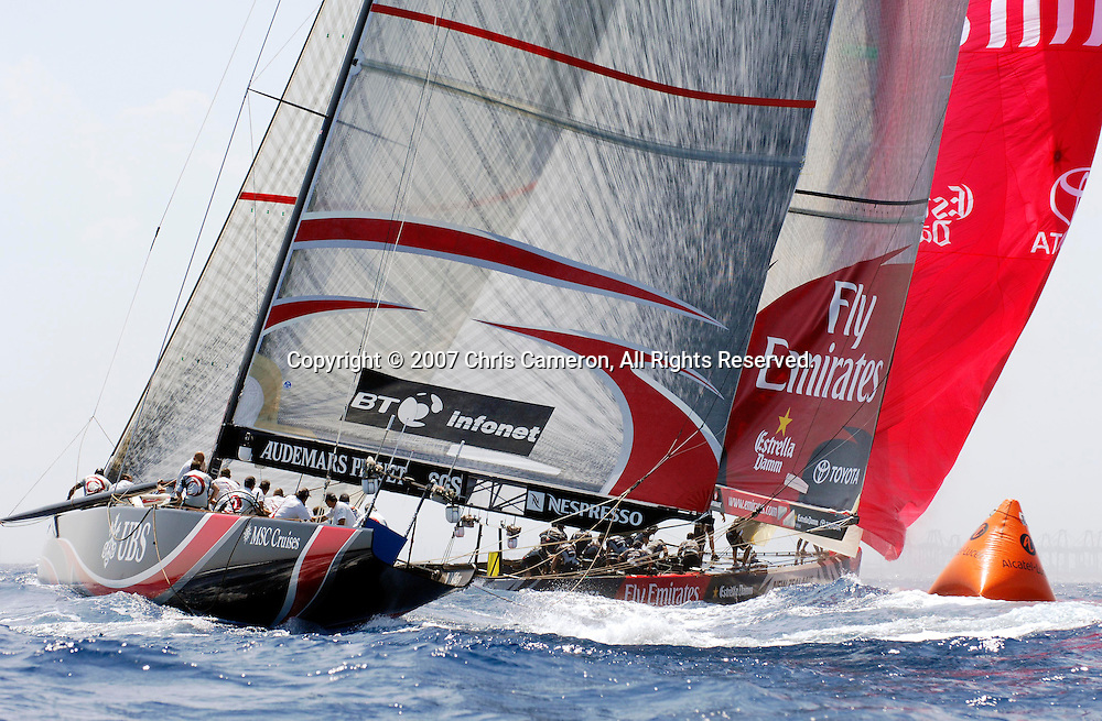 Emirates Team New Zealand NZL92 leads Alinghi SUI100 by 12 seconds at the first mark rounding in race five of the 32nd America`s Cup. 27/6/2007