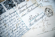 Berkeley, California, June, 2008-Old letters and postcards covered with beautiful hand written traditional script. The address is located in Paris.